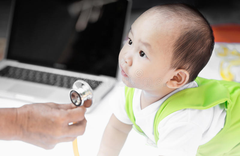 Baby portrait with stethoscope in his grand mother. stock images