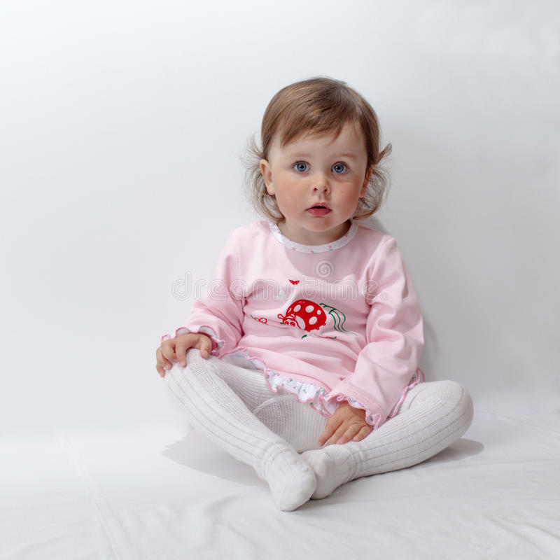 Baby posing in studio on white background royalty free stock images