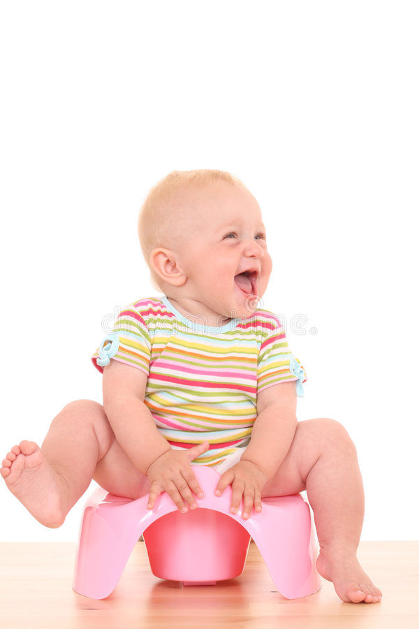 Baby on potty royalty free stock image