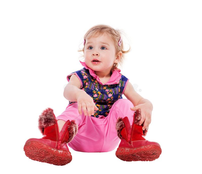 Toddler putting on shoes stock images