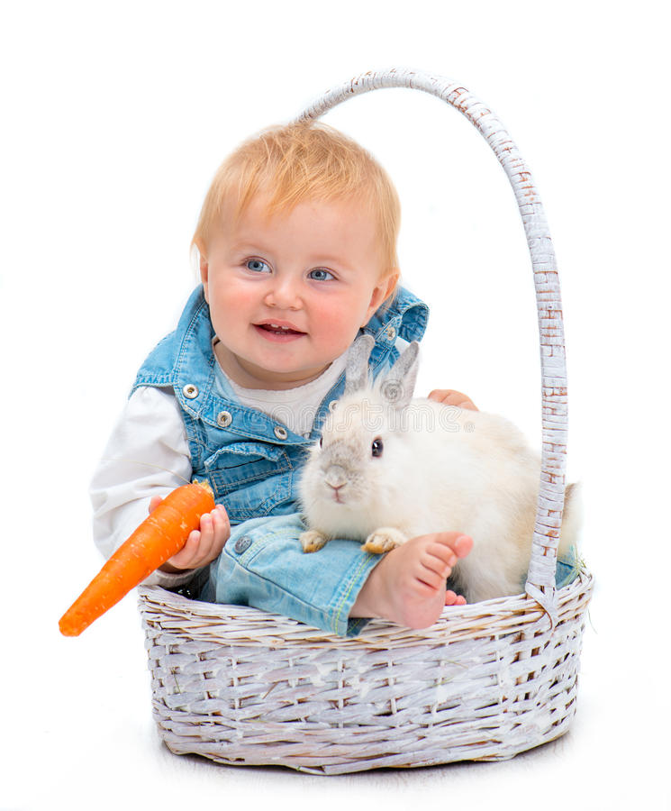 Baby with rabbit. Cute smiling baby with white rabbit isolated on a white background stock photo