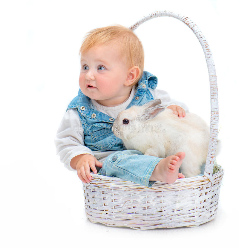 Baby with rabbit. Cute baby with white rabbit isolated on a white background stock image