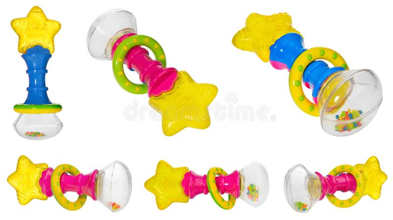 Baby rattle with a star shaped teether, multicolored hoop and ra stock images