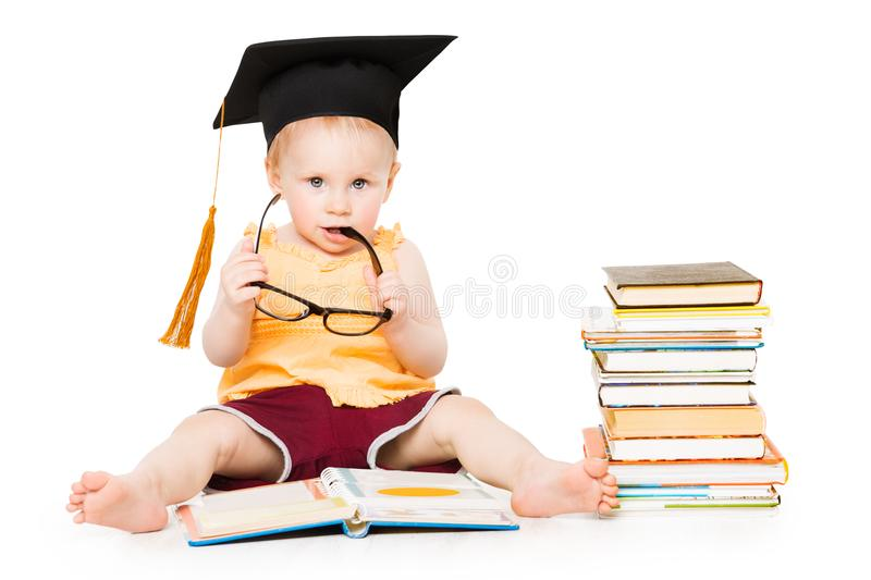 Baby Read Book in Graduation Hat and Glasses, Smart Child, White. Baby Read Book in Graduation Hat and Glasses, Smart Child Sitting Isolated over White stock image