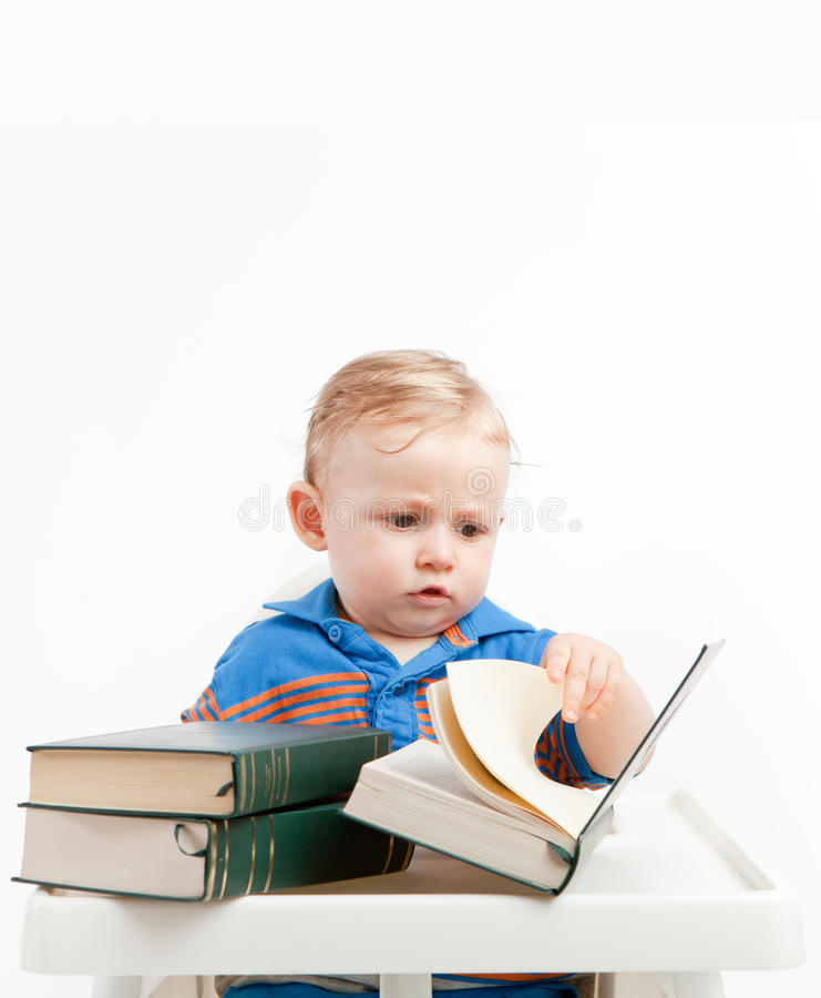 Baby reading. Little baby reading literature books stock photo