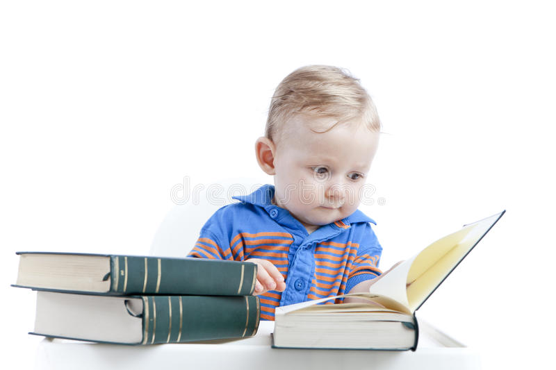 Baby reading books - education concept royalty free stock photography