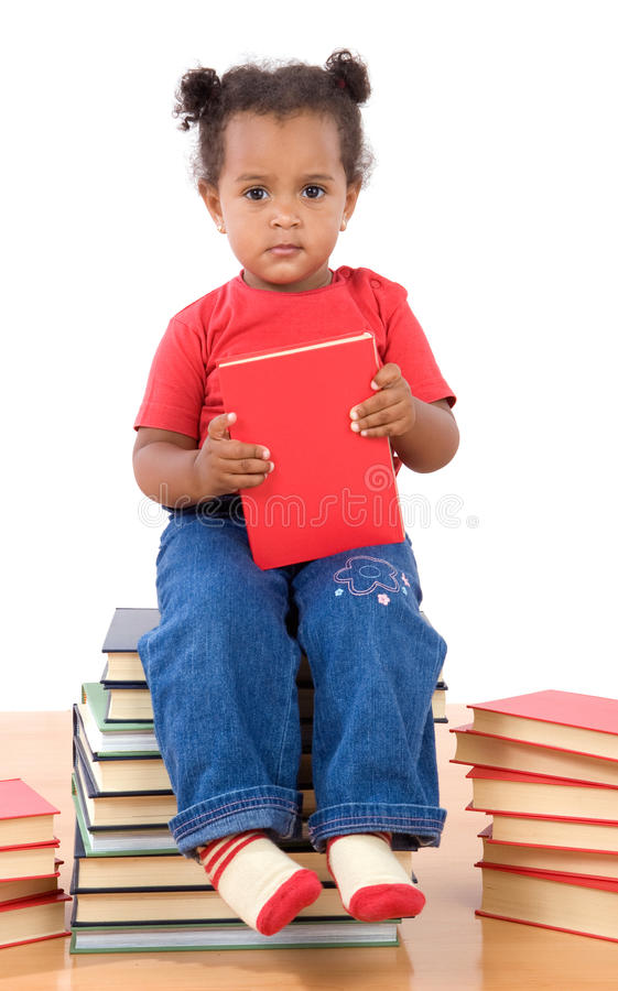 Download Baby Reading Sitting On A Pile Of Books Stock Image - Image: 13146999