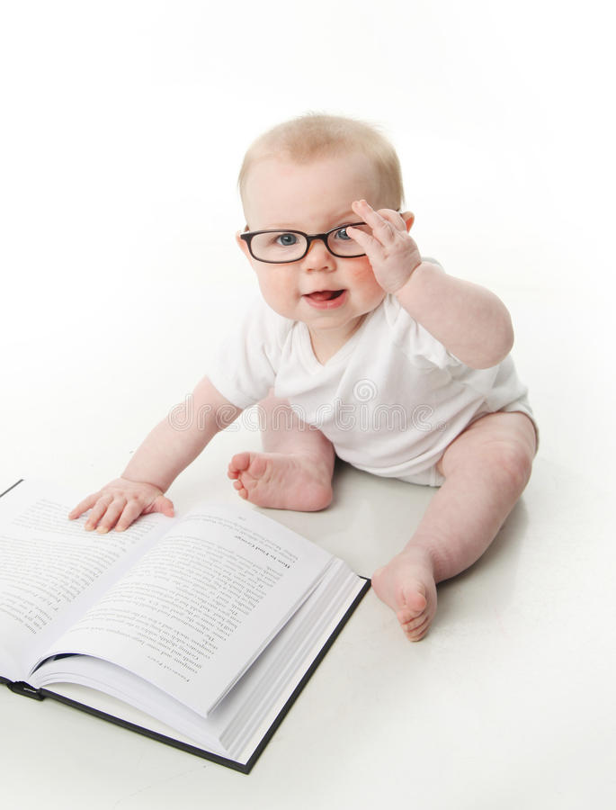 Baby reading wearing glasses royalty free stock images
