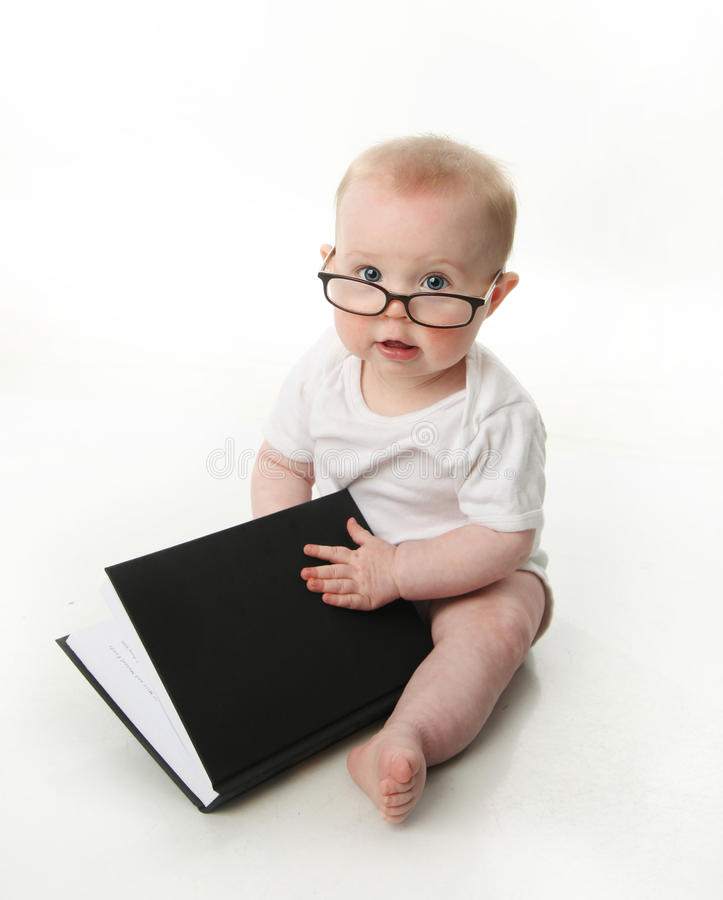 Baby reading wearing glasses royalty free stock photo