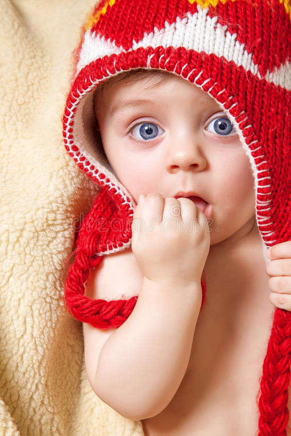 Download Baby in red bonnet stock photo. Image of amusing, cream - 36702780