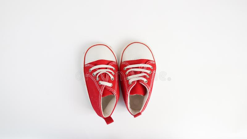 Baby red sneakers isolated on white background. baby shoes stock photo