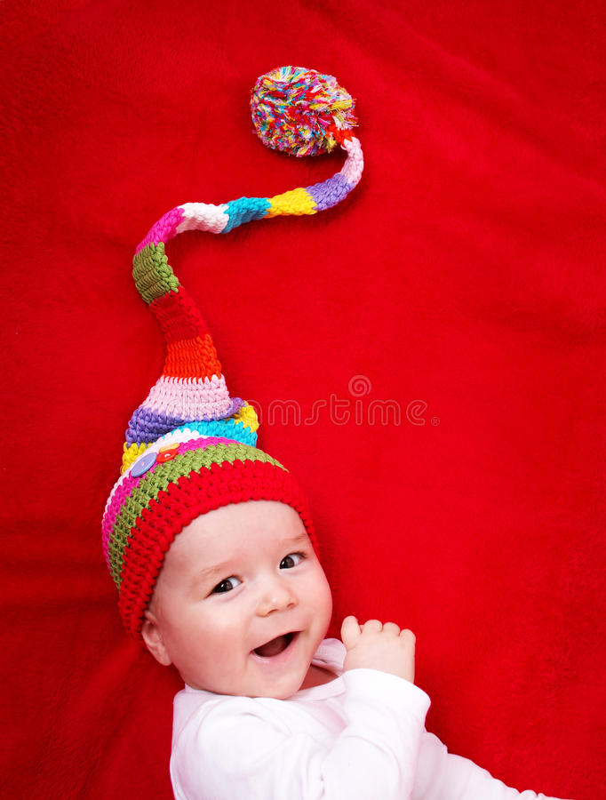 Baby in red and white hat stock images