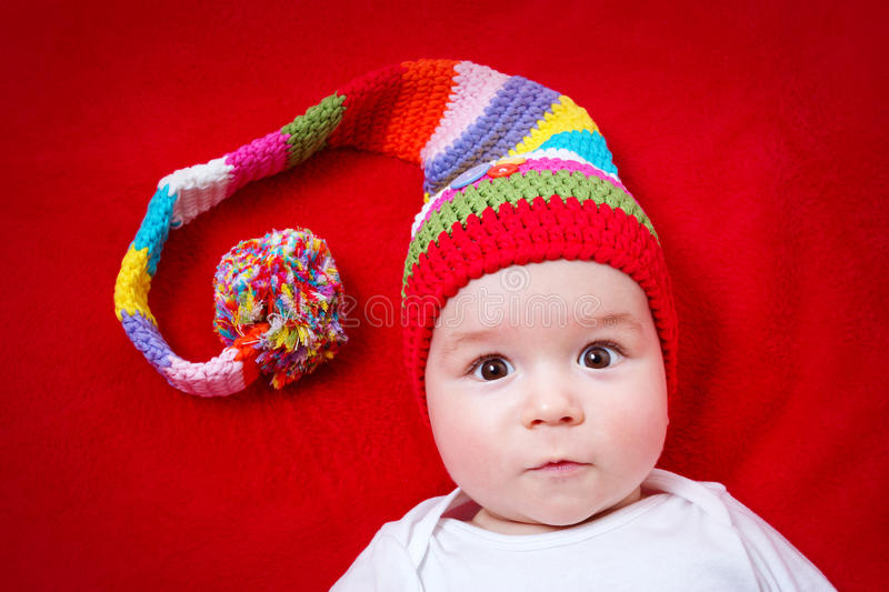 Baby in red and white hat stock photo
