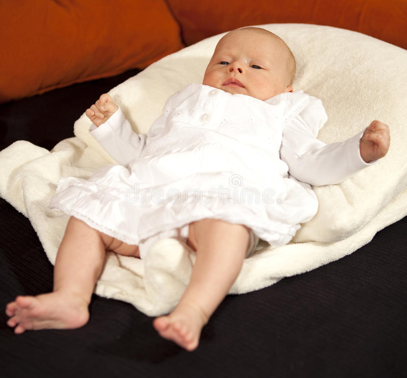 Baby relaxing on pillow