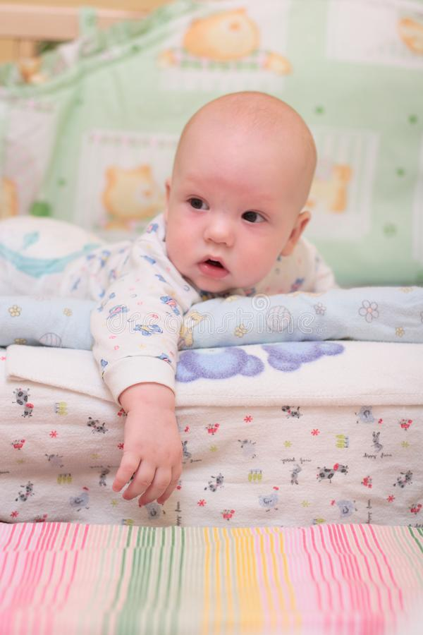 Baby rest on bed stock image
