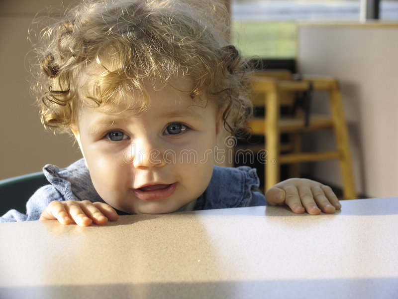 Baby in a restaurant royalty free stock photography