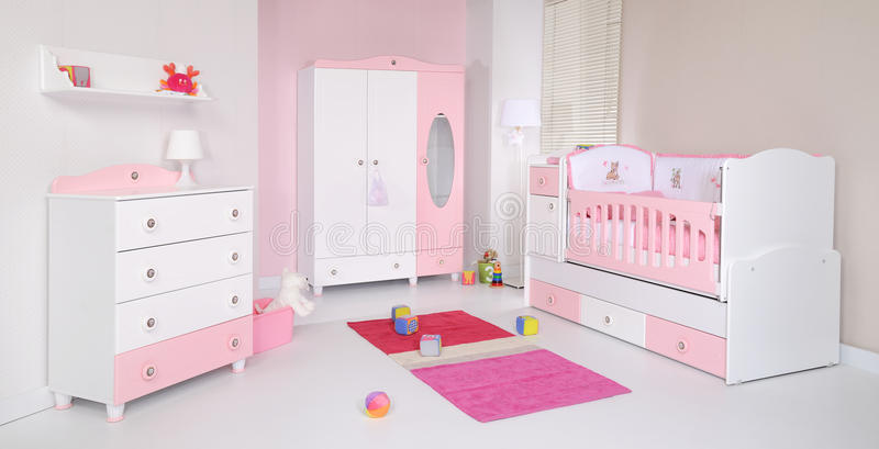 Baby room. With new furniture and toys royalty free stock photography