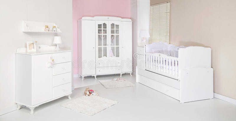 Baby room. With new furniture and toys royalty free stock photos