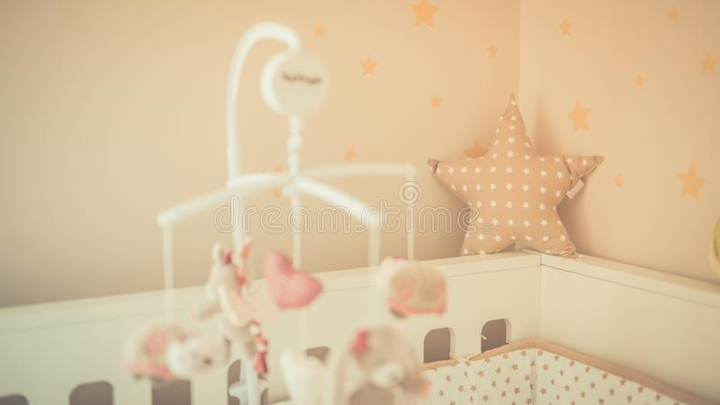 Cute baby room and baby cage background. Details and vintage toned photo stock image
