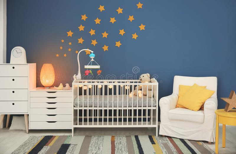 Baby room interior with comfortable crib royalty free stock images