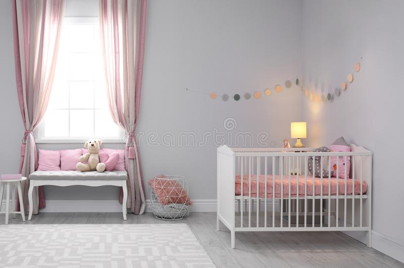 Baby room interior with comfortable crib stock images