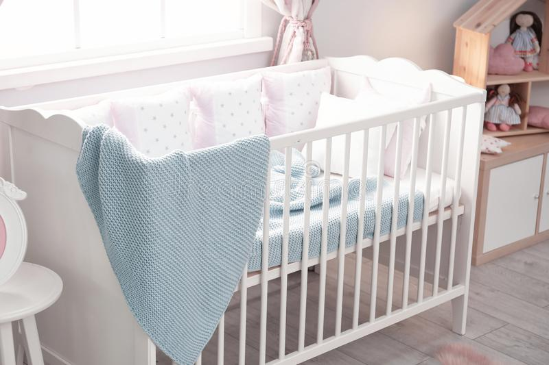 Baby room interior with crib. Baby room interior with comfortable crib royalty free stock photo
