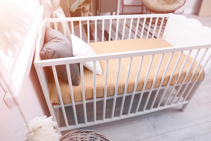 Baby room interior with crib. Baby room interior with comfortable crib stock images