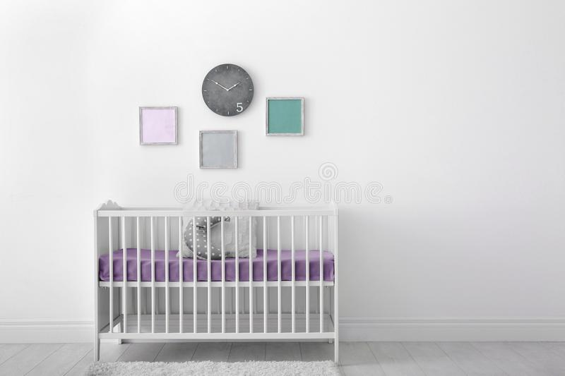 Baby room interior with crib royalty free stock images