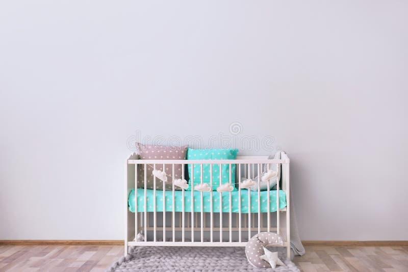 Baby room interior with crib. Near wall stock photography