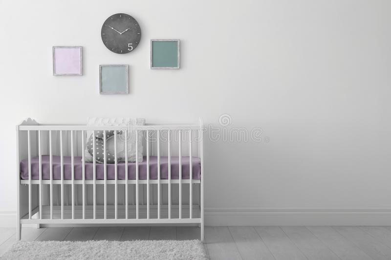 Baby room interior with crib royalty free stock image