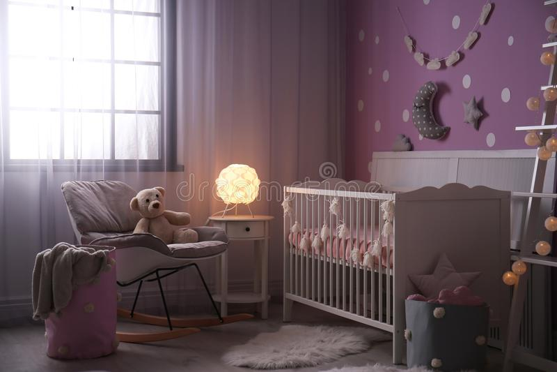 Baby room interior with crib near wall. Baby room interior with crib near color wall stock photography