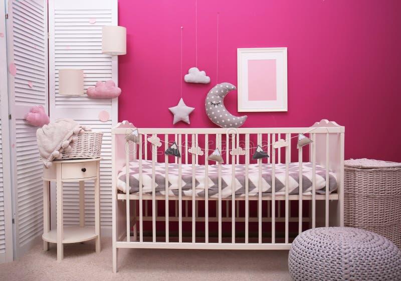 Baby room interior with crib near wall. Baby room interior with crib near color wall stock photo