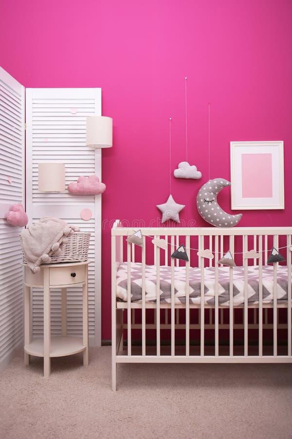 Baby room interior with crib near wall. Baby room interior with crib near color wall stock photos