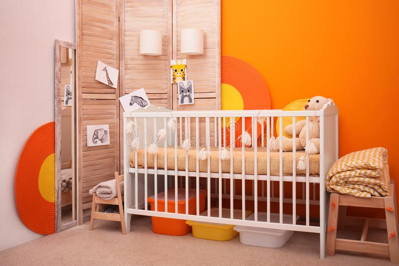 Baby room interior with crib near wall stock images