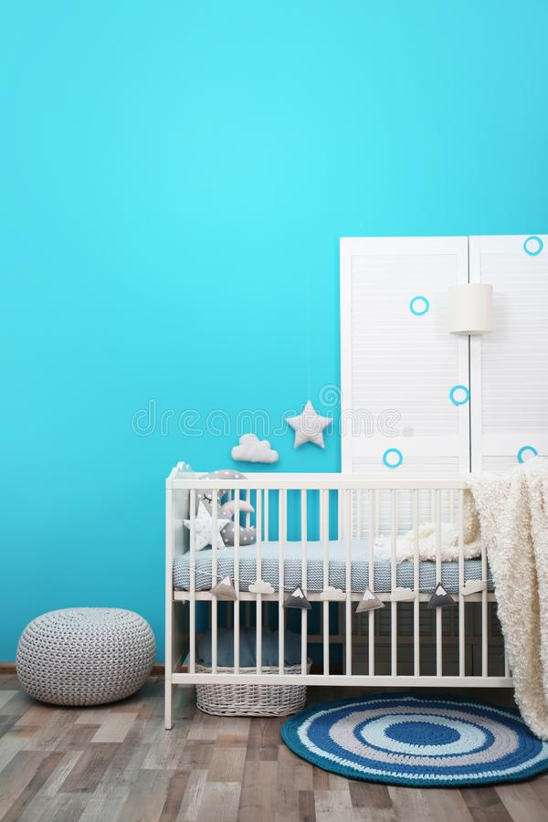 Baby room interior with crib near wall. Baby room interior with crib near color wall royalty free stock photo