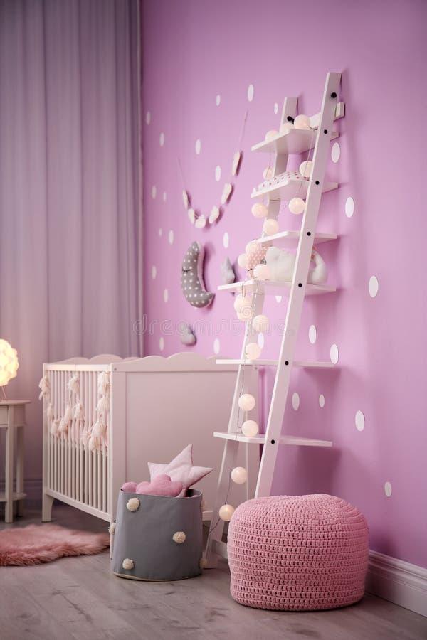 Baby room interior with crib near wall. Baby room interior with crib near color wall royalty free stock photos