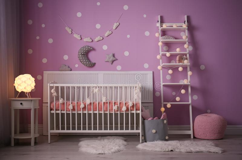 Baby room interior with crib near wall royalty free stock photo