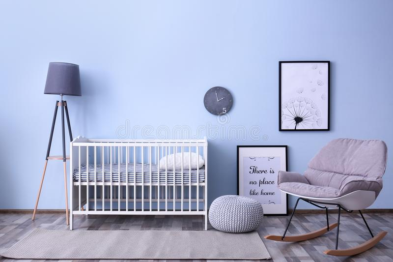 Baby room interior with crib and rocking chair wall. Baby room interior with crib and rocking chair near wall royalty free stock images