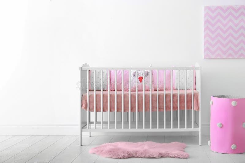 Baby room interior with crib wall. Baby room interior with crib near wall stock image