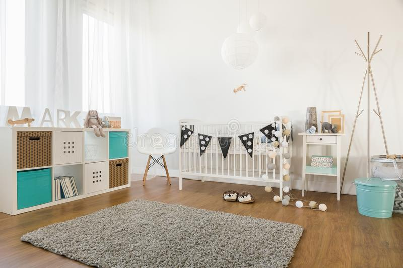 Baby room interior. Picture of cosy and light baby room interior royalty free stock photo