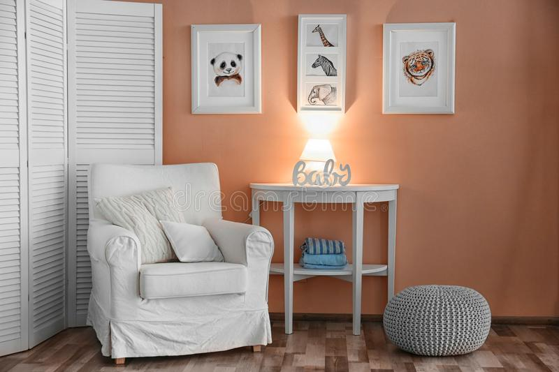 Baby room with pictures of animals stock image