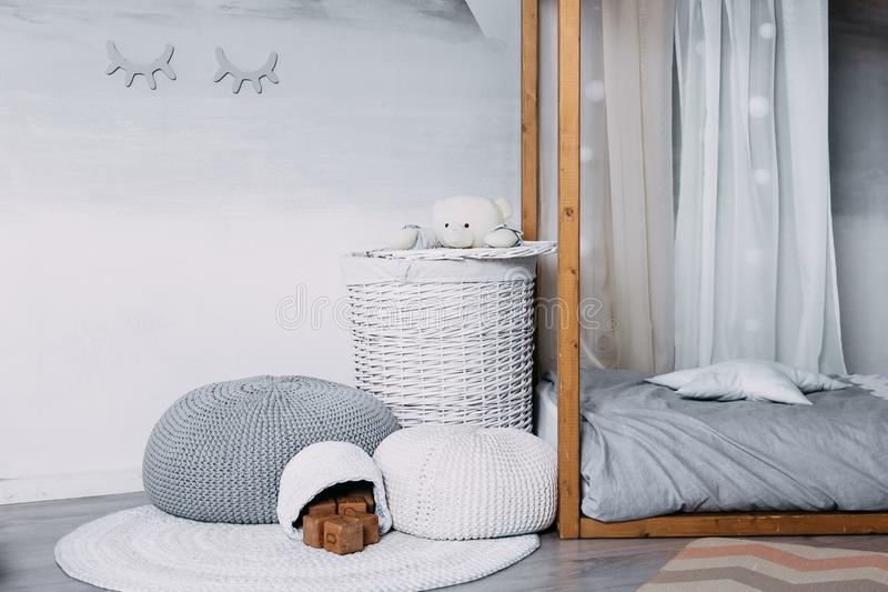 Baby room in scandinavian style with armchair and wood bed.  royalty free stock photography