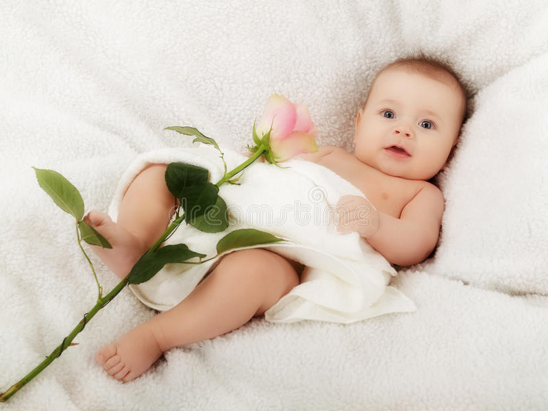 Baby with rose stock photos