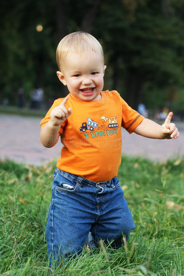 Baby run and smile royalty free stock photography