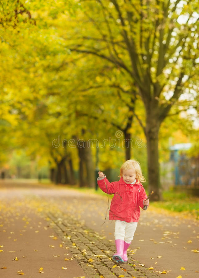 Baby running in park royalty free stock image