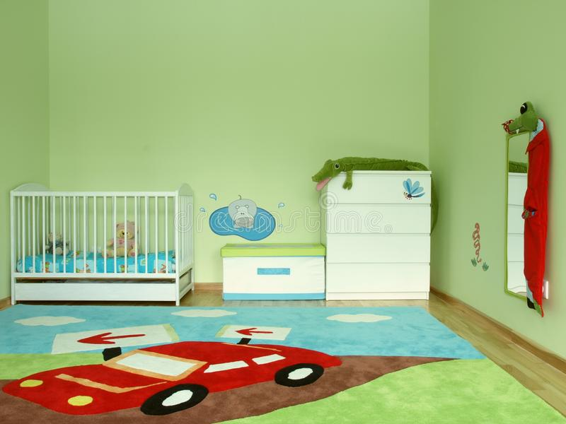 Baby's bedroom. Baby's colourful bedroom with a carpet and jungle animals royalty free stock image