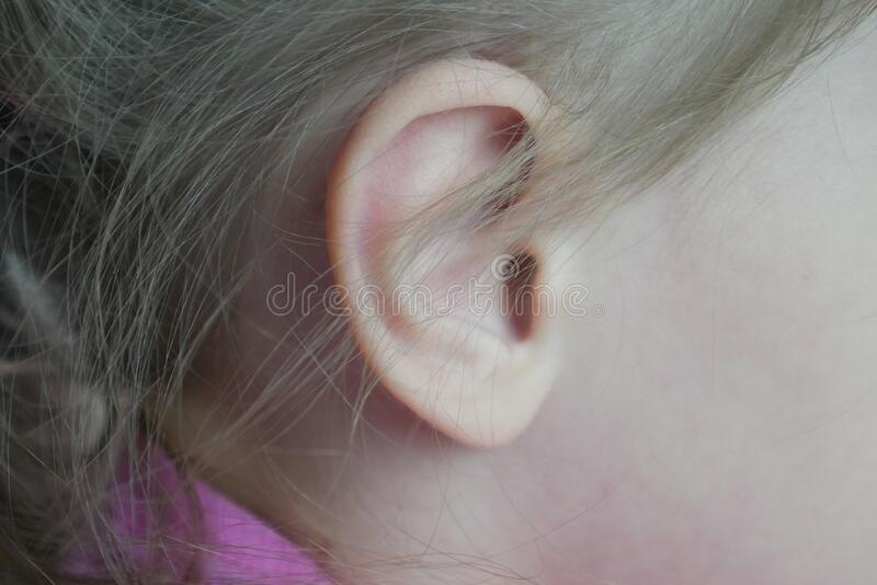 Baby`s ear close-up macro. Human anatomy. Symbol of hearing.  stock image