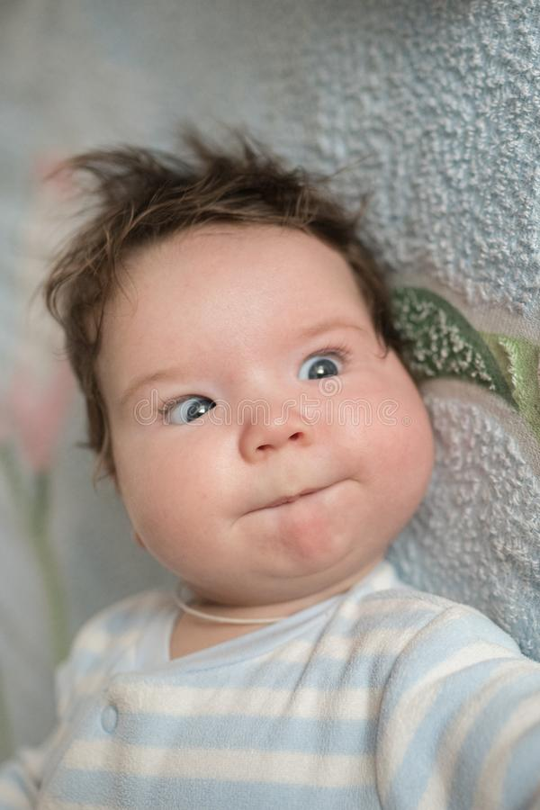The baby`s eyes squint. Special problems with the baby s eyes. Myopia, astigmatism, cross-eyed.  royalty free stock photo
