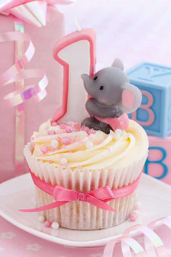 Baby's first birthday. Mini birthday cake for a baby girl's first birthday royalty free stock photo