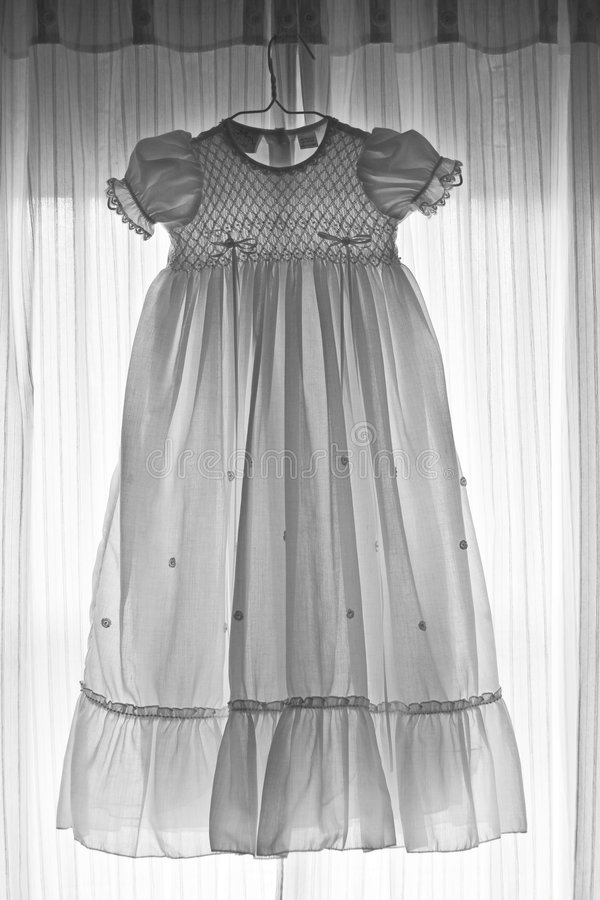 Baby's gown in black and white royalty free stock image